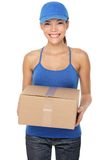 Delivery postal service woman. Holding and delivering package wearing blue cap. Woman courier smiling happy isolated on white background. Beautiful young mixed Stock Image
