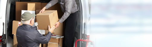 Delivery postman with a box Stock Photography