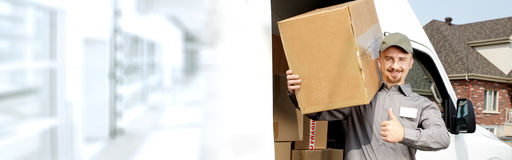 Delivery postman with a box Royalty Free Stock Photos