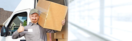 Delivery postman with a box Royalty Free Stock Photography