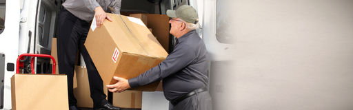 Delivery postman with a box. Professional delivery postman with a package order box stock image