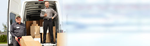 Delivery postman with a box Royalty Free Stock Image