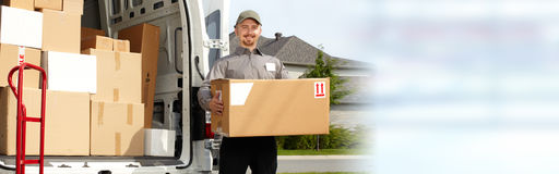 Delivery postman with a box. Professional delivery postman with a package order box royalty free stock images