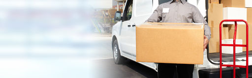 Delivery postman hands with a box. Professional delivery postman with a package order box stock photo