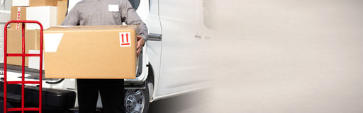 Delivery postman hands with a box. Professional delivery postman with a package order box Stock Images