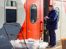 Delivery of the press to the railway car of the train Stock Photography