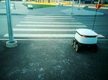 Delivery robots on the street royalty free stock image