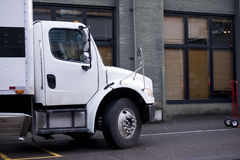 Delivery semi truck with box body standing on street of urban ci Royalty Free Stock Photography