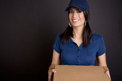 Vibrant Woman Operates Package Delivery Service Royalty Free Stock Images
