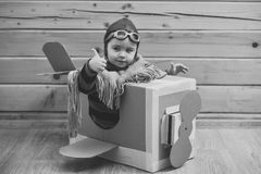 Delivery service. aircraft construction, education. Delivery service. aircraft construction education. young pilot Royalty Free Stock Images