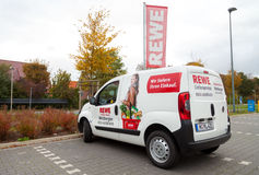 Delivery service car from german supermarket chain, REWE stands on parking area Royalty Free Stock Photos