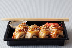 Delivery service Japanese food rolls Royalty Free Stock Photos