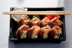 Delivery service Japanese food rolls Stock Images