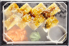 Delivery service Japanese food rolls in plastic box Royalty Free Stock Photo