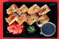 Delivery service Japanese food rolls in plastic box Royalty Free Stock Images