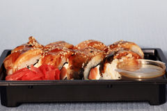 Delivery service Japanese food rolls in plastic box Royalty Free Stock Photos