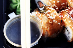 Delivery service Japanese food rolls in plastic box Royalty Free Stock Image