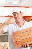 Delivery service - man holding pizza boxes. Man holding several pizza boxes in hand and asking you to order pizza for delivery Stock Photography