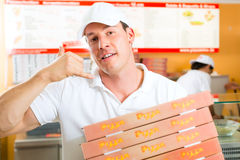 Free Delivery Service - Man Holding Pizza Boxes Stock Image - 28876261