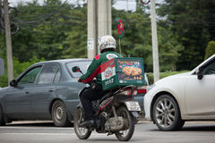 Delivery service man ride a Motercycle of The Pizza Company. CHIANG MAI, THAILAND - JULY 23  2017:  Delivery service man ride a Motercycle of The Pizza Company Royalty Free Stock Photo