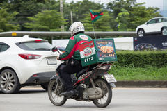 Delivery service man ride a Motercycle of The Pizza Company. CHIANG MAI, THAILAND - JULY 23  2017:  Delivery service man ride a Motercycle of The Pizza Company Royalty Free Stock Photos