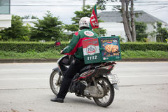 Delivery service man ride a Motercycle of The Pizza Company. CHIANG MAI, THAILAND - JULY 23  2017:  Delivery service man ride a Motercycle of The Pizza Company Stock Photography