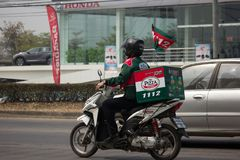 Delivery service man ride a Motercycle of The Pizza Company. Stock Image