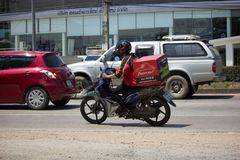 Delivery service man ride a Motercycle of Pizza Hut Company. CHIANG MAI, THAILAND -SEPTEMBER 23 2017:  Delivery service man ride a Motercycle of Pizza Hut Royalty Free Stock Images