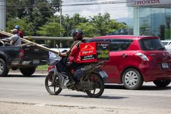 Delivery service man ride a Motercycle of Pizza Hut Company. CHIANG MAI, THAILAND -SEPTEMBER 23 2017:  Delivery service man ride a Motercycle of Pizza Hut Stock Photography