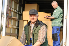 Delivery service mover man cardboard box. Male mover loading van with cardboard box delivery service Royalty Free Stock Photo