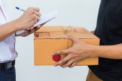 Delivery service sent to customer receiving package box. Royalty Free Stock Images