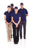 Delivery service staff. Group of delivery service staff full length portrait on white Royalty Free Stock Photography