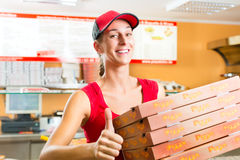 Free Delivery Service - Woman Holding Pizza Boxes Royalty Free Stock Image - 28876256