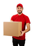 Delivery service - young smiling courier holding cardboard box Royalty Free Stock Photography
