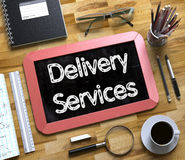 Delivery Services Handwritten On Small Chalkboard. 3D. Royalty Free Stock Image