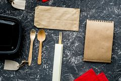 Delivery set with paper bags and flatware on gray background top Royalty Free Stock Images