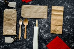 Delivery set with paper bags and flatware on gray background top Royalty Free Stock Image