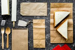 Delivery set with paper bags and sandwich on gray background top Stock Images