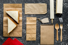 Delivery set with paper bags and sandwich on gray background top view Royalty Free Stock Images