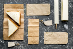 Delivery set with paper bags and sandwich on gray background top view Stock Photos
