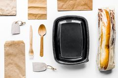 Delivery set with paper bags and sandwich white background top v. Delivery service set with paper bags and sandwich on white desk background top view mock-up royalty free stock photography