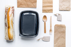 Delivery set with paper bags and sandwich white background top view mock-up. Delivery service set with paper bags and sandwich on white desk background top view royalty free stock images