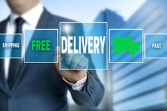 Delivery touchscreen is operated by businessman Stock Images