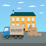 Delivery truck with cardboard boxes near house. Stock Photography