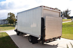 Delivery Truck/Driveway/Home. A large delivery truck parked in a driveway for unloading Stock Photography