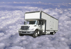 Delivery truck flying above clouds Stock Image