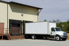 Delivery truck at loading dock Stock Images