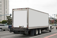 Delivery Truck. Rear and side views of white delivery trunk in city traffic Stock Photo