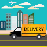 Delivery truck rides into town Royalty Free Stock Photo