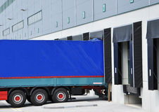 Delivery truck at warehouse Stock Photo